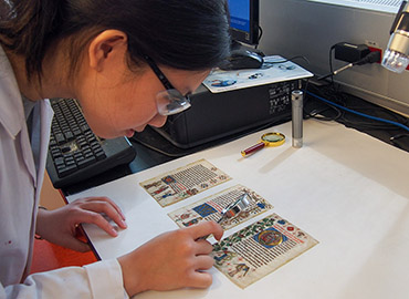Le Anh Chau Tran, a third-year arts management student, studied features of a manuscript from a Dutch prayer book