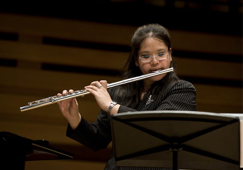 Samantha Chang playing the flute.
