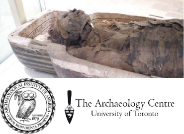 Open Egyptian sarcophagus with head of mummified Antjau on display and body wrapped in bandages.