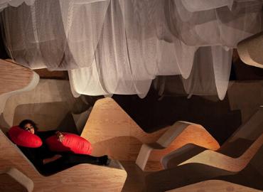 New Circadia image - students sleeping on exhibit